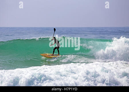 Stand up paddle boarding on the atlantic ocean - Stock Photo