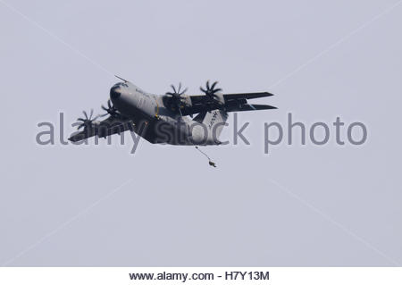 A parachutist jumps from an Airbus A400M Atlas military transport plane during a flight over RAF Weston on the Green - Stock Photo