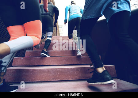 Close up view of several athletes running up the stairs while practising. Copyspace - Stockfoto