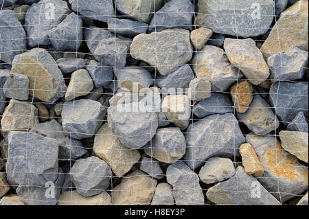 pebbles covered by the silver shiny wire mesh - Stock Photo