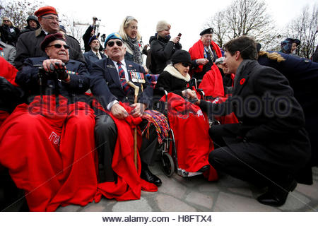 Canada's Prime Minister Justin Trudeau (R) greets veterans during Remembrance Day ceremonies at the National War - Stock Photo