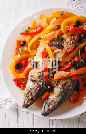 Escabeche of mackerel fish with vegetables close-up on a plate on the table. vertical view from above - Stock Photo