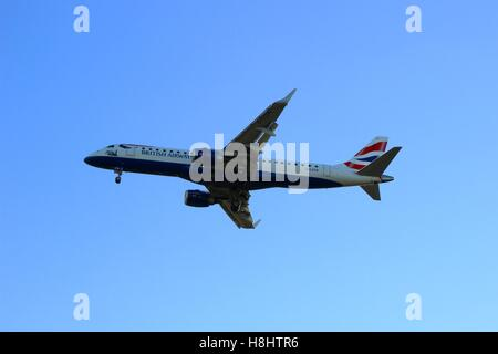 LONDON, UK - SEPTEMBER 11, 2016: An Embraer ERJ-190SR by British Airways CityFlyer (G-LCYN) during landing at LCY - Stock Photo