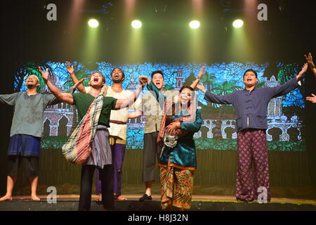 Crew of actors performing and singing during a show on stage in Kuala Lumpur, Malaysia - Stock Photo