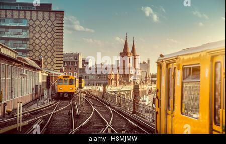 Classic view of historic Berliner U-Bahn with famous Oberbaum Bridge at sunset, Berlin Friedrichshain-Kreuzberg, - Stock Photo