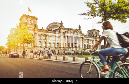 Berlin urban city life with famous Reichstag building at sunset in summer, Berlin Mitte, Germany - Stock Photo