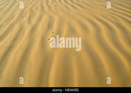 Full frame  take of rippled beach sand texture - Stock Photo