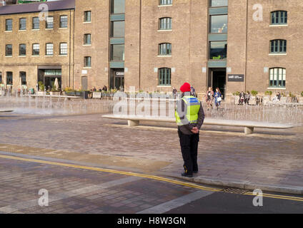 A security man at Granary Square, Kings Cross, London - Stock Photo
