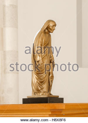 PRISTINA, KOSOVO - JUNE 2016: Sculpture of Mother Teresa in the new interior of Roman Catholic Cathedral of Blessed - Stock Photo