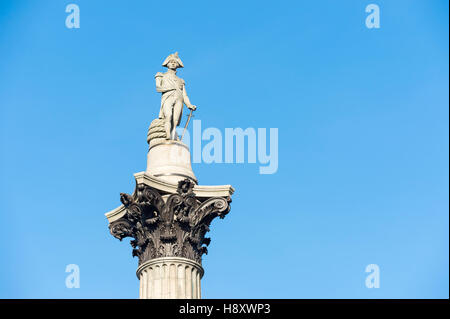 Statue of Admiral Horatio Nelson standing atop the landmark Nelson's Column in the center of Trafalgar Square in - Stock Photo