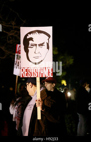 Indianapolis, Indiana, USA. 12th Nov, 2016. Anti-Trump protesters hold signs and march against United States president - Stock Photo