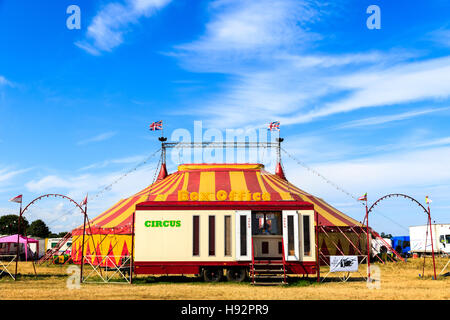 Circus tent and box office against blue sky - Stock Photo