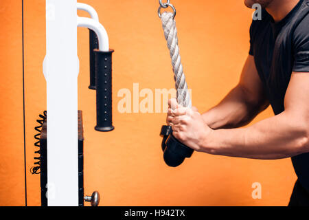 Triceps Exercise With Cables - Stock Photo