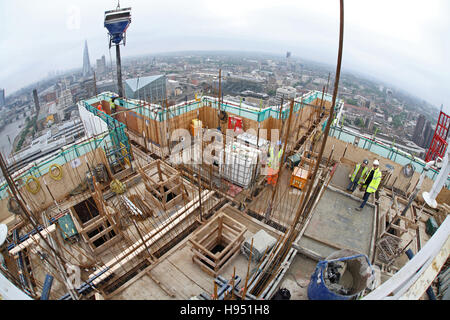 Construction of a new tower block on the south bank of the River Thames in London UK. Fish-eye view shows skyline - Stock Photo