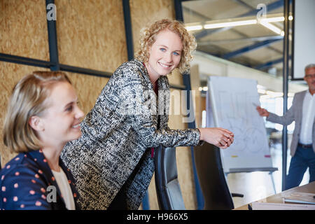 Portrait smiling businesswoman in conference room meeting - Stock Photo