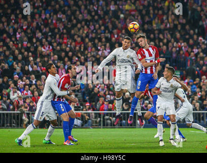 Madrid, Spain. 19th Nov, 2016. Real Madrid ?s Portuguese forward Cristiano Ronaldo  disputing a ball with Atletico - Stock Photo