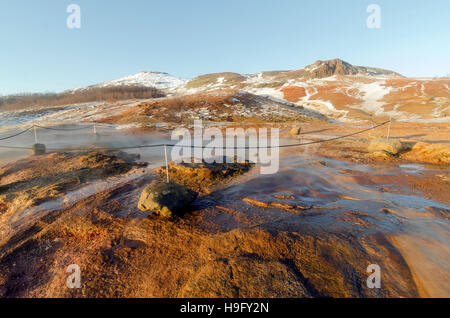 Geysir geothermal area with numerous hot springs, famous landmark attraction Golden Circle Tour Iceland - Stock Photo