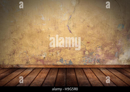 empty pattern room with wooden oak floor and orange yellow grunge concrete stone wall - Stock Photo