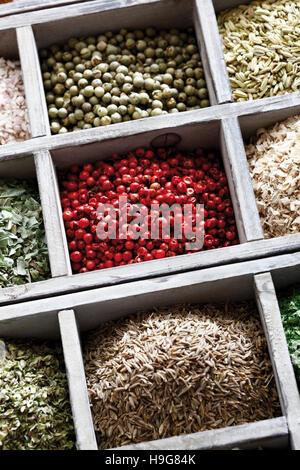 Spices in a case, pink pepper, peppercorns, cumin - Stock Photo