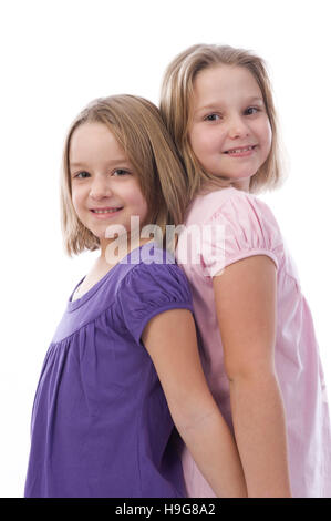 Two blonde girls, 6 and 8 years old - Stock Photo