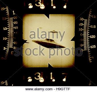 UFO flying saucer scope sighting retro mid century atomic space age - Stock Photo
