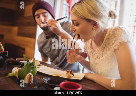 Couple eating sushi - Stock Photo