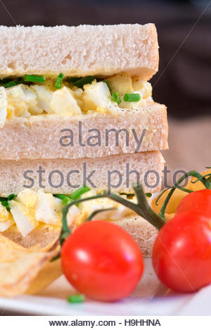 Rustic kitchen setting for fresh egg sandwich - Stock Photo