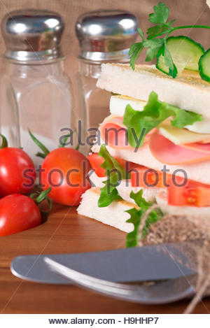 Rustic kitchen setting for fresh club sandwich - Stock Photo