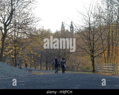 Glasgow park scene couple walking with towers of the museum in the background in kelvingrove park - Stock Photo