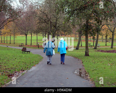 Glasgow park scene two old ladies walking on the path or road - Stock Photo