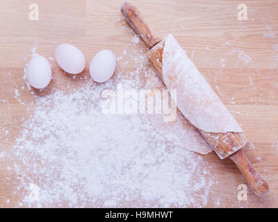 Preparation homemade pasta on wooden table. - Stock Photo