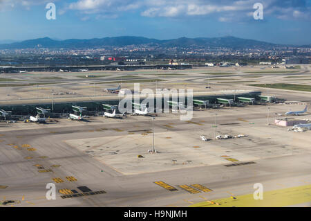 Aerial photography of Barcelona El Prat international airport with terminal T1 in the foreground. - Stock Photo