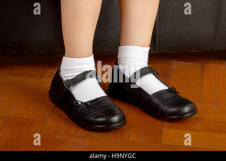legs with socks of a school in a skirt