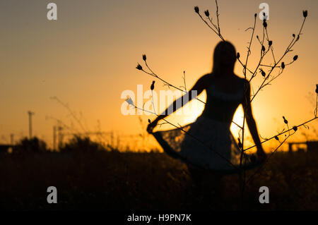 Blurred Silhouette of the beautiful girl in the nature - Stock Photo