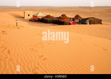 Bedouin desert camp near sanddunes of Merzouga, Morocco - Stock Photo