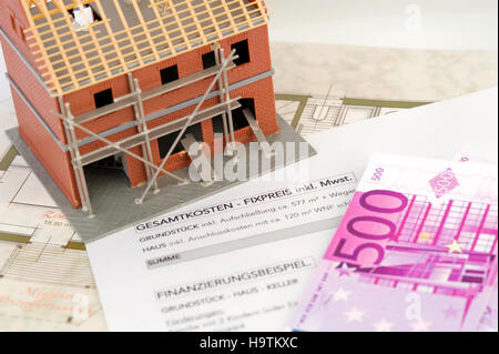 Symbolic picture for building costs stock photo royalty Construction loan costs