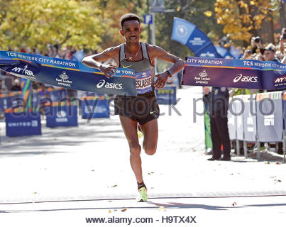 Ghirmay Ghebreslassie of Ethiopia crosses the finish line to win the mens field of the 2016 New York City Marathon - Stock Photo