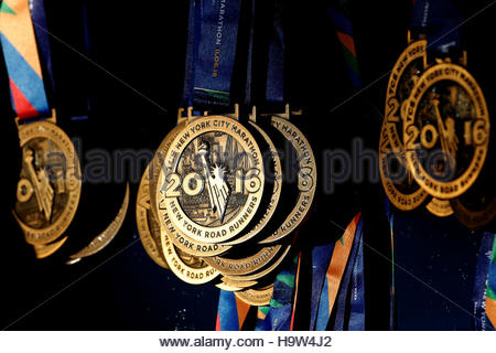 Medals are seen hanging ready for runners near the finish line ahead of the start of the 2016 New York City Marathon - Stock Photo
