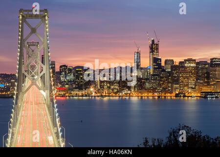 Aerial View of San Francisco-Oakland Bay Bridge and San Francisco Skyline, California, USA - Stock Photo