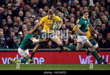 Australia's Reece Hodge is tackled by Ireland's Jared Payne during the Autumn International match at the Aviva Stadium, - Stock Photo