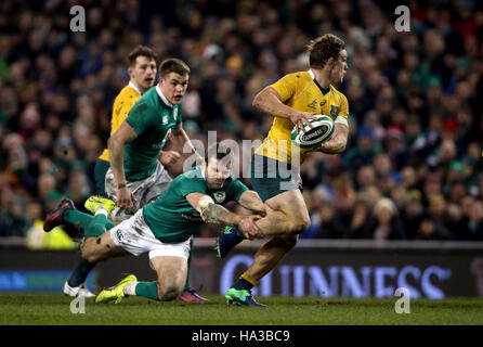 Australia's Michael Hooper is tackled by Ireland's Jared Payne during the Autumn International match at the Aviva - Stock Photo