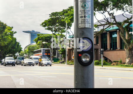button for walk cross the road in downtown singapore - can use to display or montage on product - Stock Photo