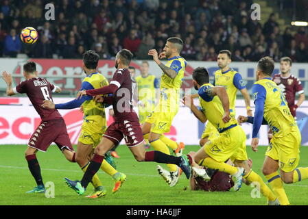 The Torino and Chievo players fighting for possession of the ball during the Serie A football match between Torino - Stock Photo