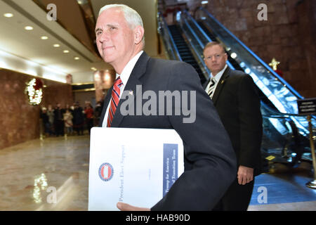 New York, USA. 28th November, 2016. United States Vice President-elect Mike Pence walks through lobby of the Trump - Stock Photo