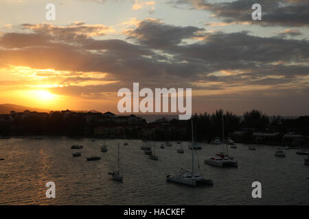 Sunset over the harbor & beaches of Montego Bay, Jamaica, Caribbean. - Stock Photo