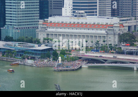 SINGAPORE - JULY 23rd, 2016: Fullerton Hotel and skyscrapers at the Marina Bay - Stock Photo