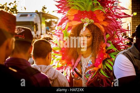 Reveller from the Euphoria Carnival mas band's Notting Hill Carnival 2016 presentation, Celebrating Life, passing - Stock Photo