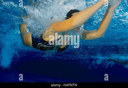 Female swimmer, 20 year-old, training the butterfly style in a pool in Steyr, Upper Austria, Europe - Stockfoto