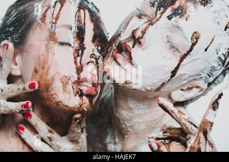 two girls doused with white and dark chocolate. passionate women - Stockfoto
