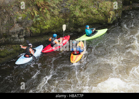 High angle view of kayakers on River Dee rapids, Llangollen, North Wales - Stock Photo